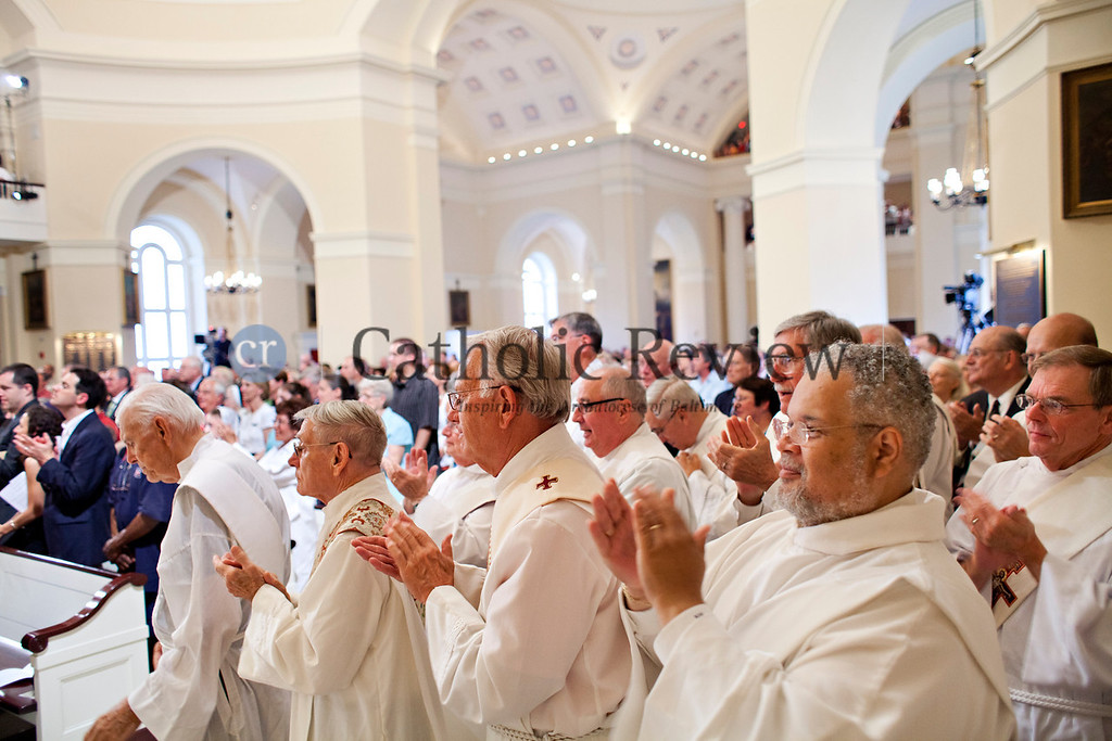 Deacons join in the applause as Archbishop William E. Lori concludes the Homily during the Opening Mass for the Fortnight for Freedom at the Basilica of the National Shrine of the Assumption of the Blessed Virgin Mary in Baltimore June 21. (Tom McCarthy Jr. | CR Staff)