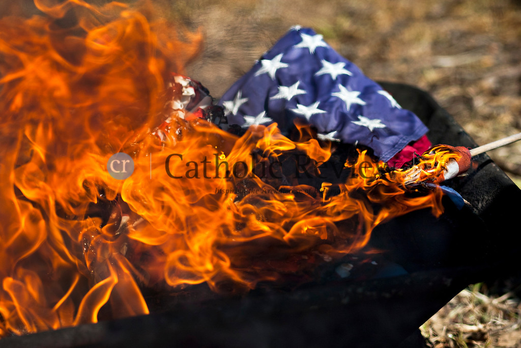 Members of the Knights of Columbus celebrate a Patriotic Ceremony for the Retirement of American Flags at St. Clement Mary Hofbauer, Rosedale along with members of Boy Scouts troops 355 and 303 June 22. TOM McCARTHY JR. | CR STAFF