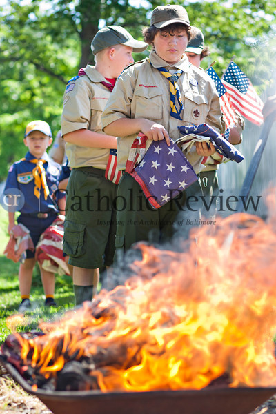 Boy Scout Charles Pietrusek participates in a Patriotic Ceremony for the Retirement of American Flags at St. Clement Mary Hofbauer, Rosedale June 22. TOM McCARTHY JR. | CR STAFF