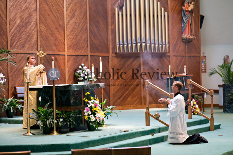 As part of the Fortnight for Freedom, Father Gerard Francick leads members of the faithful in the Exposition of the Blessed Sacrament following an observance of the Patriotic Rosary at St. Mark, Fallston June 23. TOM McCARTHY JR. | CR STAFF