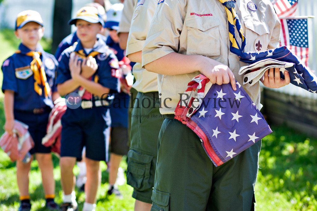 Members of  Boy Scouts troops 355 and 303 prepare to dispose of old flags during a Patriotic Ceremony for the Retirement of American Flags at St. Clement Mary Hofbauer, Rosedale June 22. TOM McCARTHY JR. | CR STAFF