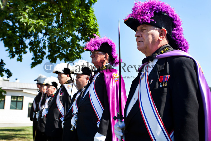 Jim Chachulski stands with other members of the Knights of Columbus colorguard during a Patriotic Ceremony for the Retirement of American Flags at St. Clement Mary Hofbauer, Rosedale along with members of Boy Scouts troops 355 and 303 June 22. TOM McCARTHY JR. | CR STAFF