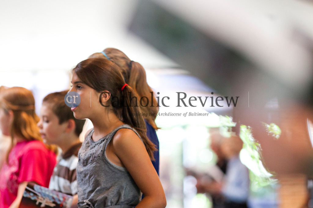 As part of the Fortnight for Freedom, Rachel Richard, 11, sings the National Anthem during an observance of the Patriotic Rosary at St. Mark, Fallston June 23. TOM McCARTHY JR. | CR STAFF