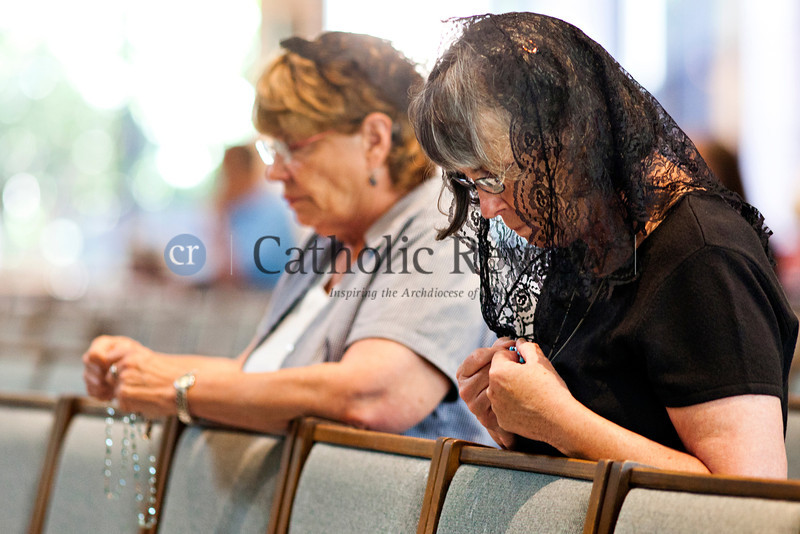 As part of the Fortnight for Freedom, Candy Scheidel and her sister Melanie Keegan participate in an observance of the Patriotic Rosary at St. Mark, Fallston June 23. TOM McCARTHY JR. | CR STAFF