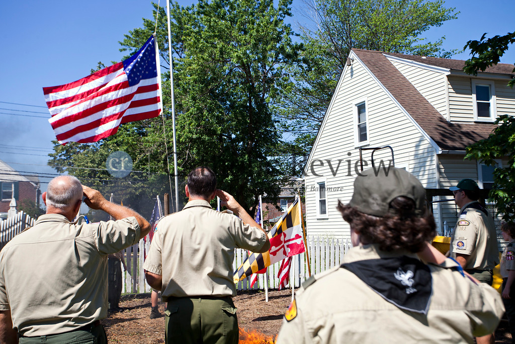 Members of Boy Scouts troops 355 and 303 salute the flag after a Patriotic Ceremony for the Retirement of American Flags at St. Clement Mary Hofbauer, Rosedale June 22. TOM McCARTHY JR. | CR STAFF
