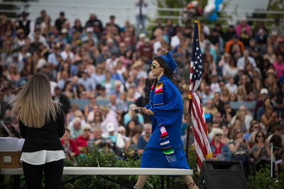 Mary Manjarrez walks across the stage as her name was read aloud during the graduation ceremony on June 16.  (Sam Armanino / Times-Standard)