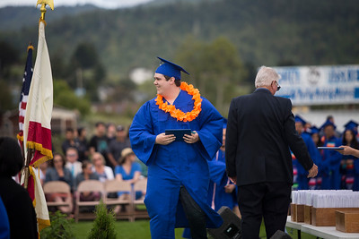 Fortuna High graduate Jeremiah Hartley walks across the graduation stage during the ceremony on June 16.  (Sam Armanino / Times-Standard)
