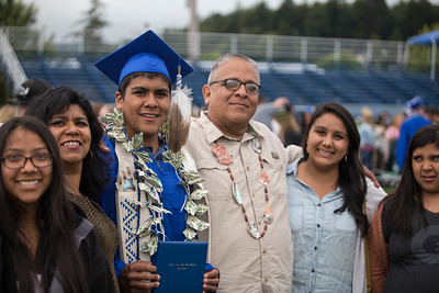 Matthew Jacob Hernandez enjoys his graduation ceremony on June 16 with his family. He plans on going into the marines after.  (Sam Armanino / Times-Standard)