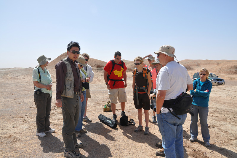 It was incredibly windy in this corner of the Gobi.  Here's Hailu describing the site and discussing our plan of prospecting for the morning.  From left to right: Christie, Hailu, Becky, Jack, Matt, Brenna, Jessie, Mike, Brad, and Diane.