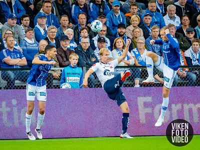 Sarpsborg 08s Mustafa Abdellaoue og Sarpsborg 08s Matti Lund Nielsen. Foto: Thomas Andersen