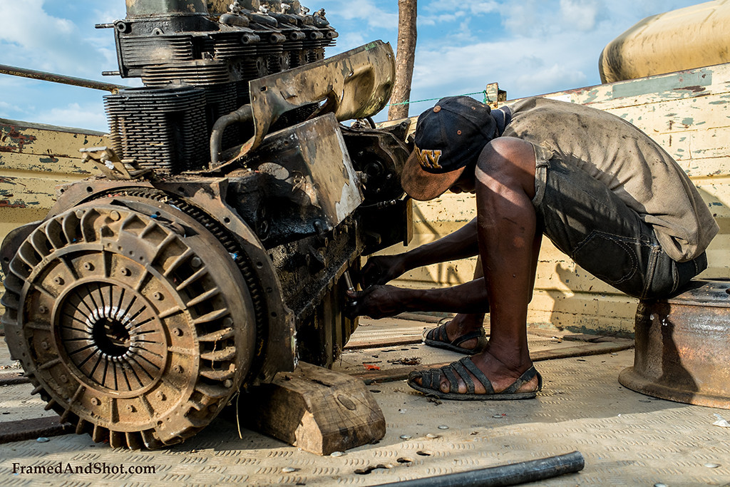 "<p style=""color:#F4F2F5""></p><h4>And some had work to do, like this man; working on an old engine in front of the church.</h4>"