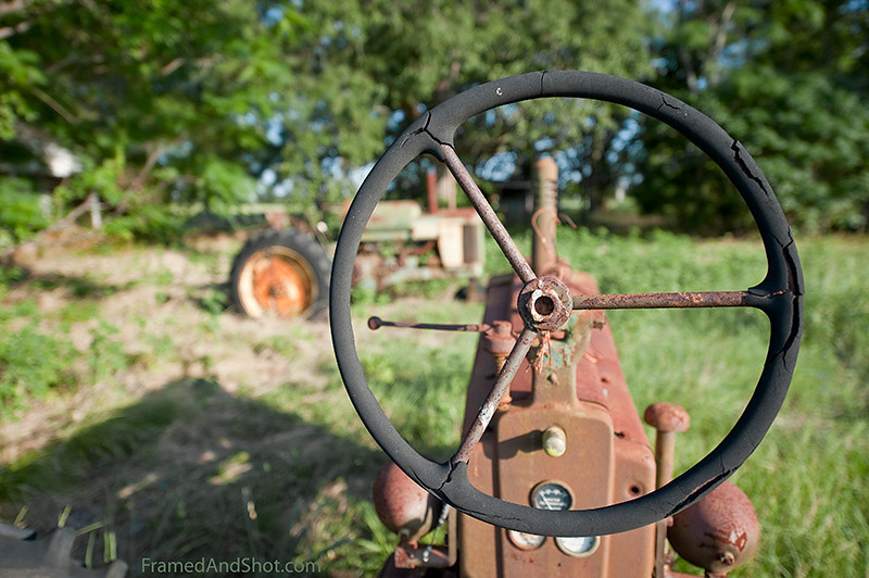 """<h4>Landscape with Tractor<br> This is another view of the tractor in the previous post.  This was a genuine tractor graveyard.  We have borrowed the tittle from <a href=""""http://www.pshares.org/issues/article.cfm?prmarticleID=1518"""">Henry Taylor and his poem """"Landscape with Tractor""""</a>. <span style=""""color: #0080FF""""></span>"""