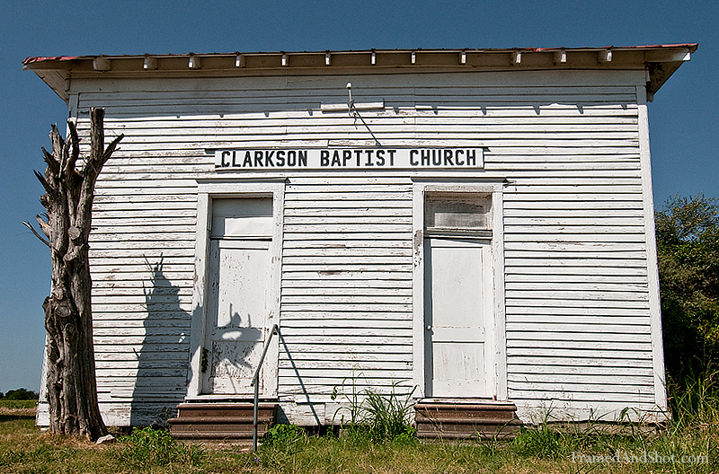 <h4>Clarkson Baptist Church<br> Religion is important in the south, and most places have large and impressive churches. This belongs to the more modest style. And who knows, maybe money is not everything. There's not too much known about Clarkson, Clarkson is a ghost town, resting peacefully in the middle of north-central Texas farmland. It had a post-office from 1889 through 1906, when mail was moved to Rosebud. In 1903 Clarkson had two local schools, one for 43 white students, one for 105 black students. By the 1940s, Clarkson's population had dwindled to 50. In 1990 it was down to 10. Today, Clarkson consists of a few scattered farmhouses still occupied, the old Clarkson Baptist Church, the Clarkson Cemetery with old and new tumbstones, and the old schoolhouse down the road is falling into disrepair.