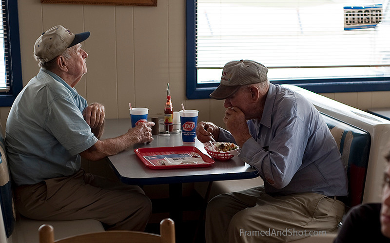 <h4>Breakfast (not at Tiffany's)<br> The owners of the car in the previous shot. These guys were enjoying their breakfast at the local Dairy Queen. It would have been more authentic to us if it was a barbecue shack, but no such luck! And no woman looking the slightest like Audrey Hepburn either…. So this quote from the book will have to do: <em>[I]t's better to look at the sky than live there.  Such an empty place; so vague.  Just a country where the thunder goes and things disappear.  </em>~Truman Capote, Breakfast at Tiffany's, 1958, spoken by the character Holly Golightly