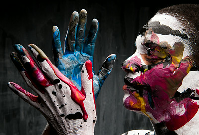 Painted hands and face