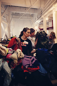 Athletes of the U.S. Ski Team, U.S. Snowboarding and U.S. Freeskiing volunteer at the coat drive hosted by New York Cares in New York City in the wake of Hurricane Sandy. Photo: Sarah Brunson/USSA