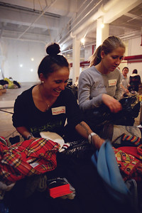 Ashley Battesrby and KC Oakley Athletes of the U.S. Ski Team, U.S. Snowboarding and U.S. Freeskiing volunteer at the coat drive hosted by New York Cares in New York City in the wake of Hurricane Sandy. Photo: Sarah Brunson/USSA