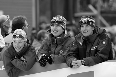 USA's Kikkan Randall (left) watches the races on the big screen with Chandra Crawford and Magda Genuine in Otepaeae, Estonia Photo Credit: Pete Vordenberg