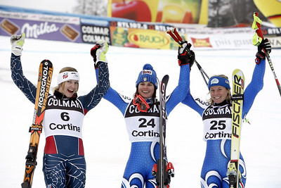 CORTINA D'AMPEZZO, ITALY - JANUARY 21:  (FRANCE OUT) (L-R) Julia Mancuso of the USA, second place, Karen Putzer of Italy, first place, and Denise Karbon of Italy, third place, celebrate after the FIS Skiing World Cup Women's Giant Slalom on January 21, 2007 in Cortina d'Ampezzo, Italy.  (Photo by Agence Zoom/Getty Images)