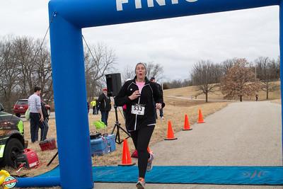 Tara Tendon of KCRW finishes the 5k.