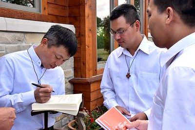 Truc signs the house book