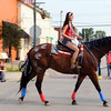 Taylor Dammerman of Effingham rides Missy on loan from Rose Bloemer as part of the St. Francis Animal Hospital's parade contingent. The animal hospital will be open for business later this month. Chet Piotrowski Jr. / Piotrowski Studios