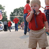 One-year-old Porter Hille of Effingham waits for his handful of candy during the Effingham Fourth of July parade Saturday afternoon. Chet Piotrowski Jr. / Piotrowski Studios