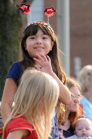 Eight-year-old Araya Lake of Effingham waves to parade participants Saturday afternoon. Chet Piotrowski Jr. / Piotrowski Studios