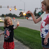 Ava and Ashlynn Sheehan, 4 and 7 respectively, of Effingham play with sparklers at Effingham Junior High School prior to the fireworks display Saturday evening. Chet Piotrowski Jr. / Piotrowski Studios