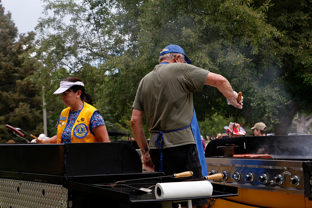 . Jennie Votaw, left, and Carl Bosack, right, from  Loveland Lions Club, take on the lunch rush at North Lake Park on Tuesday, July 4, 2017. Loveland Lions Club ran concessions for the Independence Day Festivities. (Michelle Risinger/ Loveland Reporter-Herald)