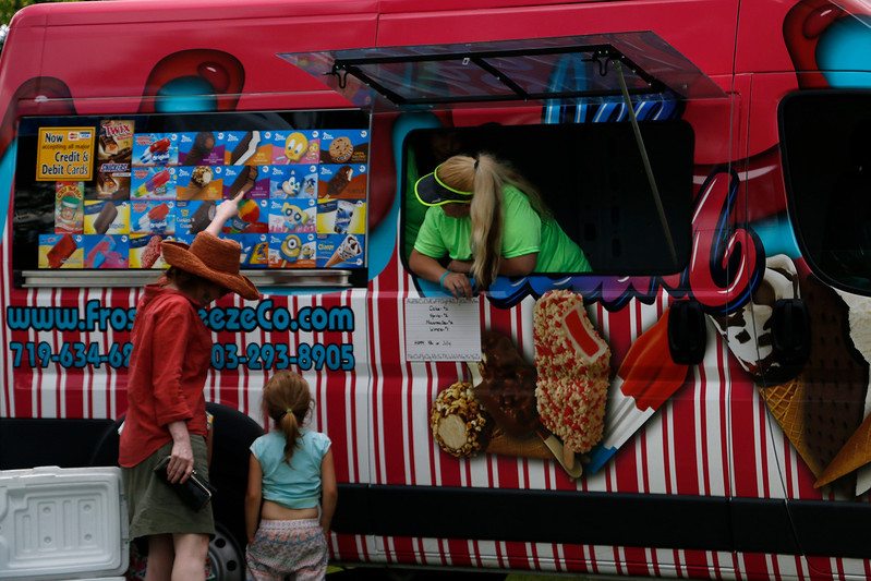 Loveland Classical School brings in an ice cream truck to North Lake Park on Tuesday, July 4, 2017 to celebrate Independence Day. (Michelle Risinger/ Loveland Reporter-Herald)