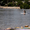 Faith Turner, 12, paddle boards at North Lake Park on July 4, 2017. Her family has held the same spot for fireworks for years and they set up the night before to ensure they get it. (Michelle Risinger/ Loveland Reporter-Herald)