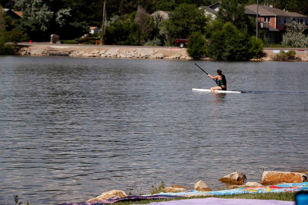 . Faith Turner, 12, paddle boards at North Lake Park on July 4, 2017. Her family has held the same spot for fireworks for years and they set up the night before to ensure they get it. (Michelle Risinger/ Loveland Reporter-Herald)