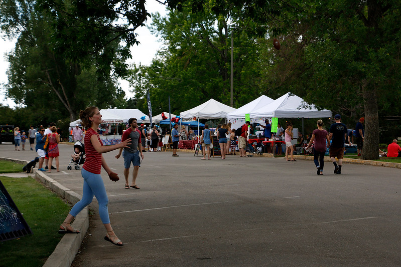 Loveland locals and visitors celebrate Independence Day on Tuesday, July 4, 2017 at North Lake Park. Vendors and booths line a strip of the park with food and games. (Michelle Risinger/ Loveland Reporter-Herald)