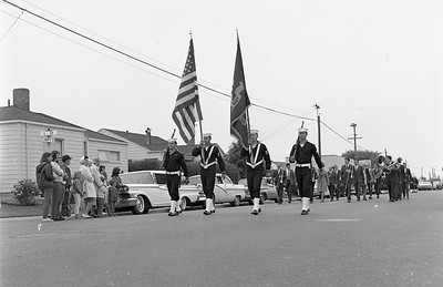 Men from two naval vessels, USS Rexburg and USS Cove, marched in the July 5, 1965 Eureka Active 20-30 Club Parade. This photo was taken at the corner of Harris and L streets in Eureka. (Times-Standard file photo)