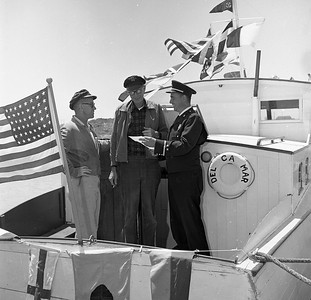 Valley of the Giants Jubilee Chairman David Saunders, right, explains to Eureka Harbor Commission Chairman C.S. Morris plans for the July 4, 1965 boat parade along the Eureka waterfront, while Jim Turk of the U.S. Coast Guard Auxiliary listens in. Morris' craft, the DelCaMar, was the first entry in the parade. Saunders, a Eureka fireman, started the annual Valley of the Giants Jubilee. (Times-Standard file photo)