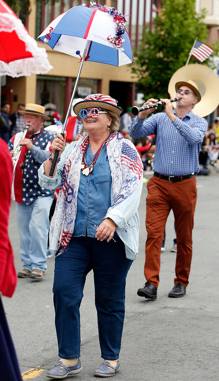 . Lisa Seabring strut their way down Calle Principal with members of the Monterey Hot Jazz Society and the Dancing Jubulators during the Fourth of July parade in downtown Monterey on Tuesday July 4, 2017. (David Royal for the Monterey Herald)