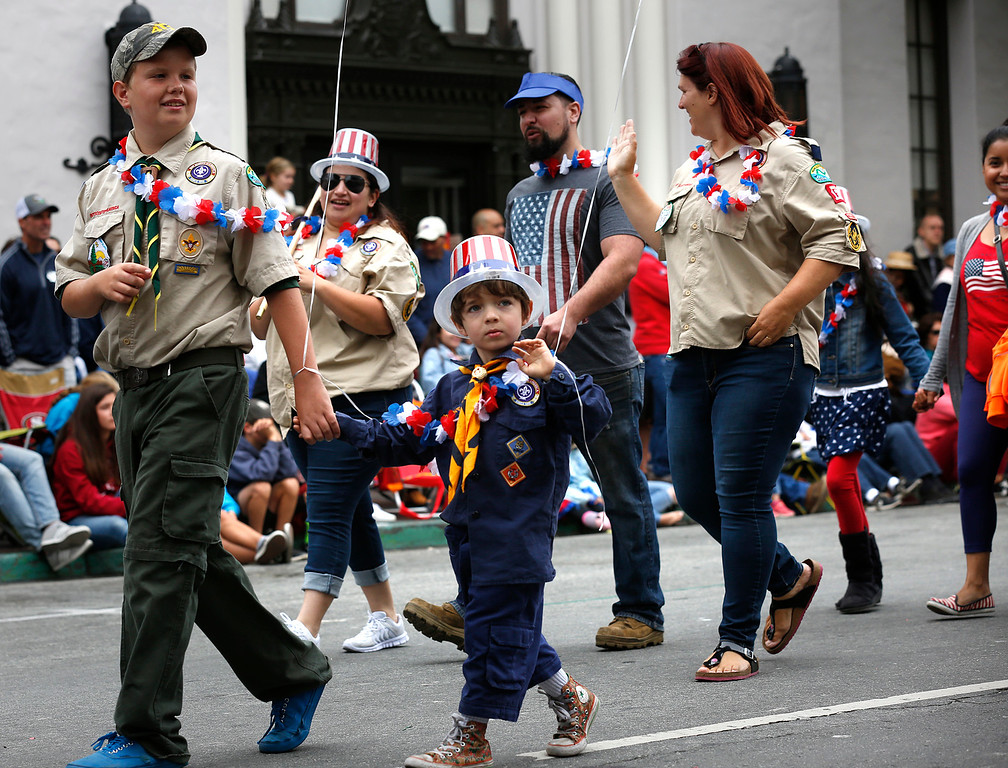 . Members of Cub Scout Pack 135 march during the Fourth of July parade in downtown Monterey on Tuesday July 4, 2017. (David Royal for the Monterey Herald)