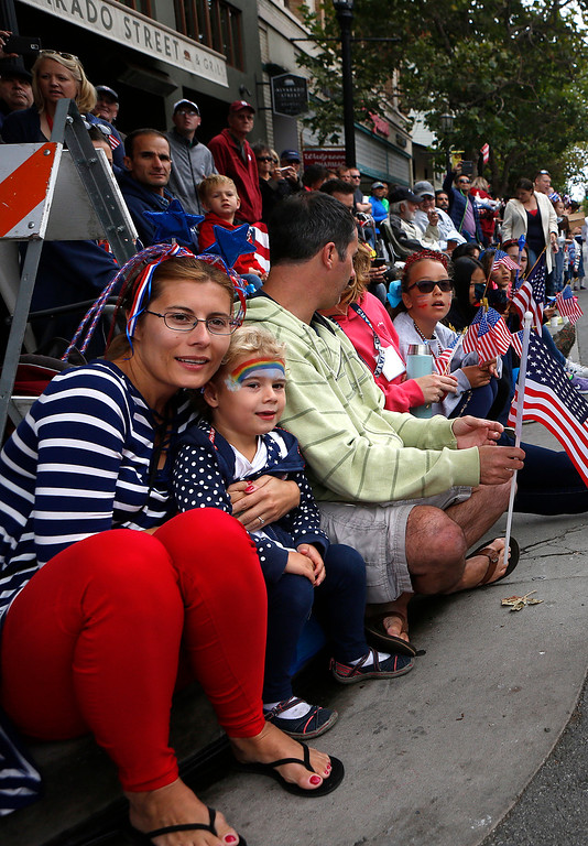 . Martha Butterfield and her daughter Maya, 4, watch the Fourth of July parade in downtown Monterey on Tuesday July 4, 2017. (David Royal for the Monterey Herald)