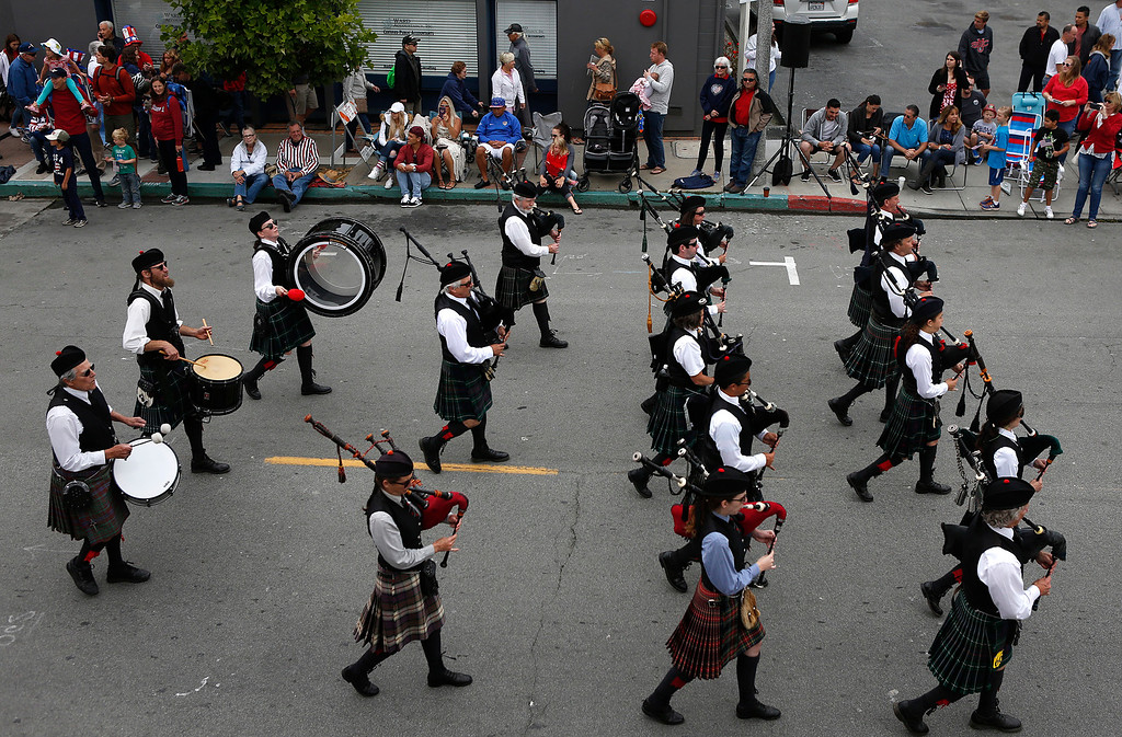 . The Monterey Bay Pipe band march during the Fourth of July parade in downtown Monterey on Tuesday July 4, 2017. (David Royal for the Monterey Herald)