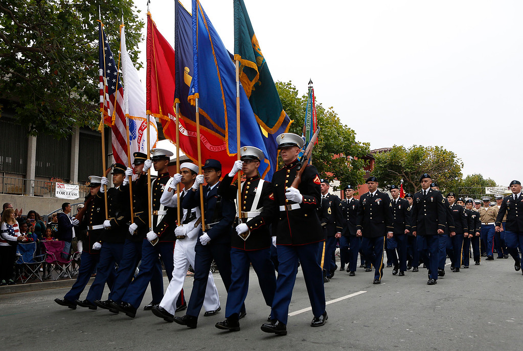 . Members of the DLI Joint Services Color Guard march down Alvarado Street during the Fourth of July parade in downtown Monterey on Tuesday July 4, 2017. (David Royal for the Monterey Herald)