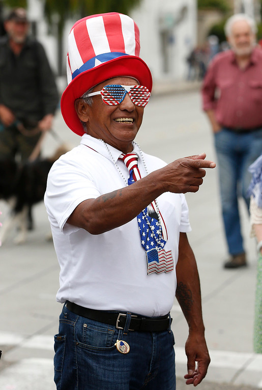 . Joseph Rivera gets in the spirit during the Fourth of July parade in downtown Monterey on Tuesday July 4, 2017. (David Royal for the Monterey Herald)