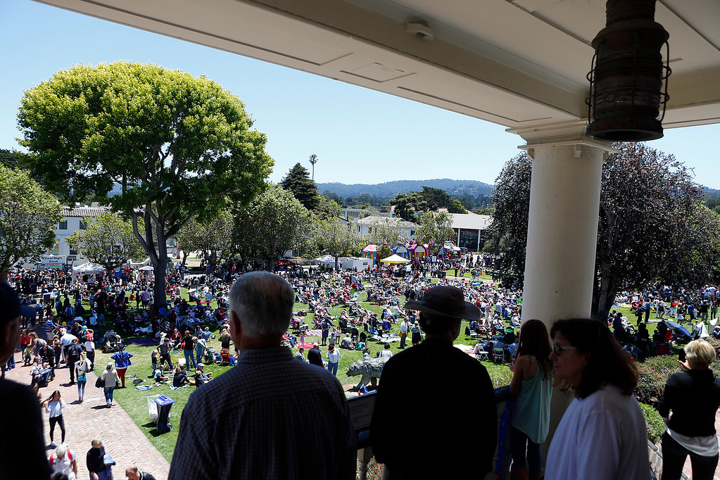 . People gather outside Colton Hall for the Fourth of July party in downtown Monterey on Tuesday July 4, 2017. (David Royal for the Monterey Herald)