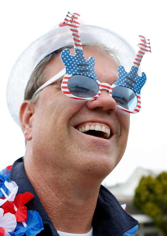 . Bob Burke watches the Fourth of July parade in downtown Monterey on Tuesday July 4, 2017. (David Royal for the Monterey Herald)