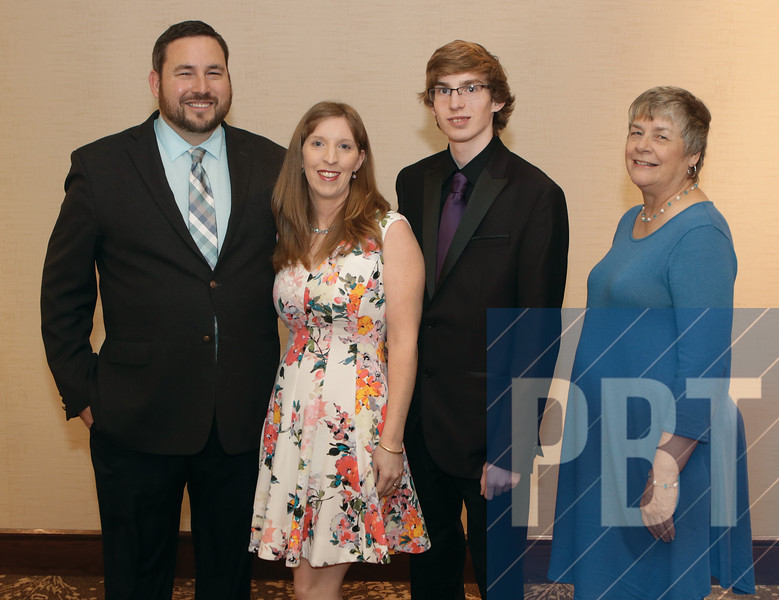 Award Winner Dan Dillman of A2U, with his wife, Jenn, son Brendan and mother Diane Wheelus.
