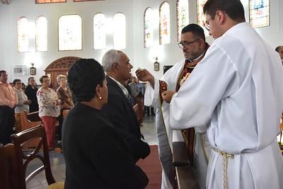 Fr. Juan Carlos gives his parents Communion