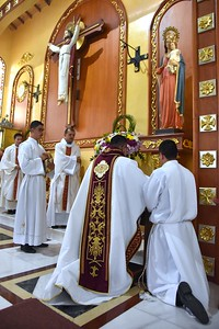Fr. Juancho prays before the Blessed Mother
