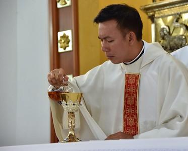 Fr. Vien helps to prepare the altar