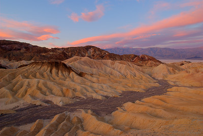 Sunrise at Zabriski Point Death Vally National Park, California  I was lined up shoulder to shoulder with 10 other photographers. We were all wondering if it was going to be worth it; we'd risen before dawn and were standing out in freezing weather.  Then, like magic, the sun broke over our back left shoulder, and the light came alive.   Shot with a Nikon D80 and Tamron 11-17 mm