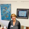 Cathryn Robinson of Florida stands in front of her beautiful artwork.